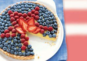 white cranberry pear balsamic custar  tart with fresh berry topping